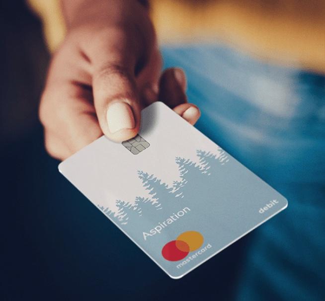 Photo of hand holding Aspiration debit card